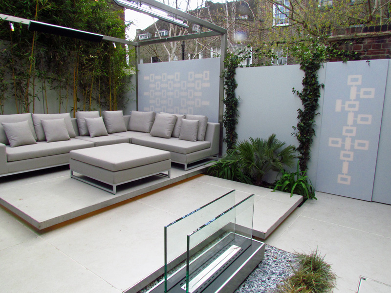 Steel pergola over a contemporary seating area