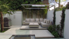 a modern ethanol fire feature as the focal point to this small back garden